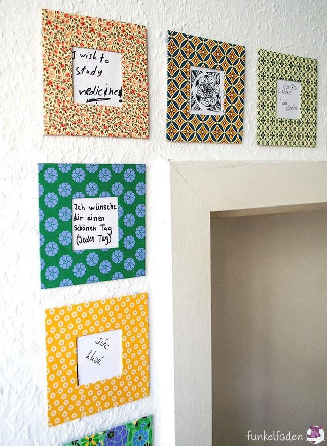 Wand mit Bilderrahmen aus Pappe und Wünschen